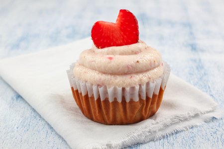 Delicious Strawberry Shortcake Cupcakes with strawberry frosting and fresh Strawberry Hearts