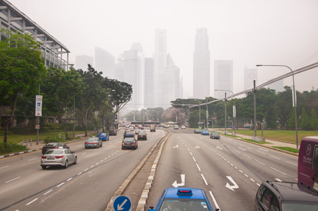 heavy effect: SINGAPORE - OCTOBER 05, 2015 : Traffic is seen at Raffles Boulevard  area in heavy smog which effect from yearly wildfire in Indonesia. Editorial