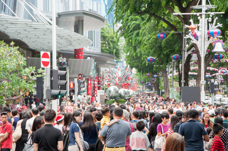 SINGAPORE - DEC 25 : crowded people at Orchard road, Singapore on Christmas day.