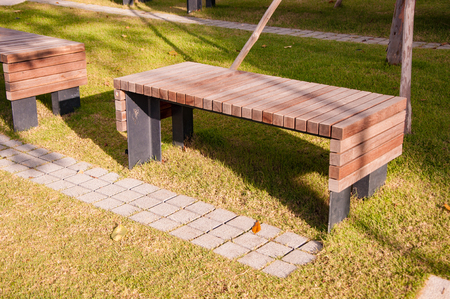 metal structure: wooden park bench with metal structure in garden