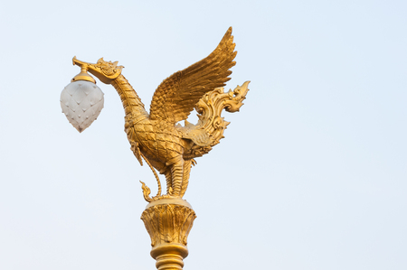lamp on the pole: Thai traditional golden swan lamp pole isolate Stock Photo