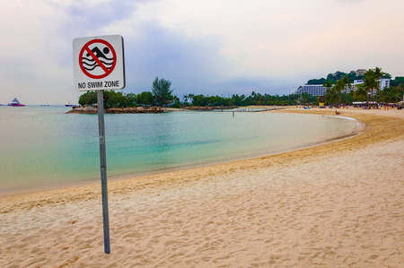 no swimming: no swimming zone sign at the beach