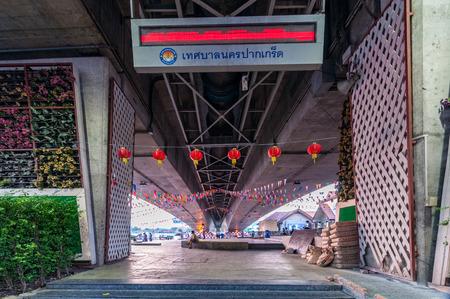 nonthaburi: Nonthaburi, Thailand-April 10, 2016 : public space in evening at riverfront under Rama4 bridge, Pakkret, Nonthaburi, Thailand