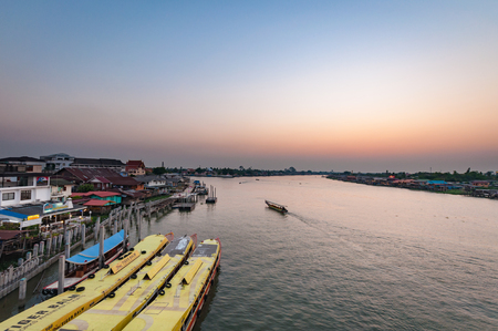 nonthaburi: Nonthaburi, THAILAND - April 10: 2016.Sundown with town below Time Pakkret is a small town in the Chao Phraya River. on April 10, 2016 in Nonthaburi Province, Thailand.