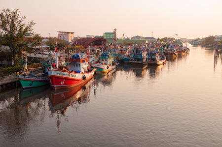 samutprakarn: APRIL 11,2016 - Thai Fishing vessels in Mahachai estuary fishing village in evening, Samutprakarn, Thailand