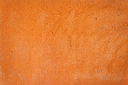 daubed: orange cement wall background texture
