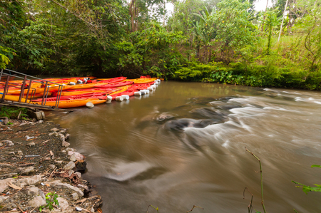 rapidly: many plastic canoe dock in rapidly river