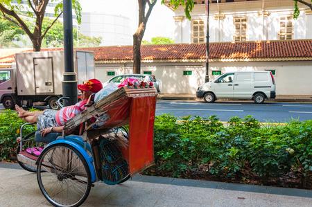 trishaw: Singapore - JUNE 22 2016: A trishaw man waiting for customer at Bras Basah Road Editorial