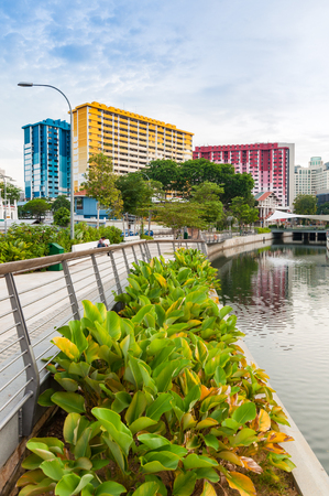 sg: SINGAPORE -23 JUNE 2016 : Built in 1977 by the Singapore Housing and Development Board, the Rochor Centre is a series of colorful buildings along the Rochor canal. It will be demolished in 2016. Editorial