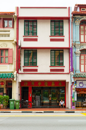 june 25: SINGAPORE - JUNE 25, 2016 : antique style shophouse building in Chinatown in Singapore on 25 June 2016 Editorial