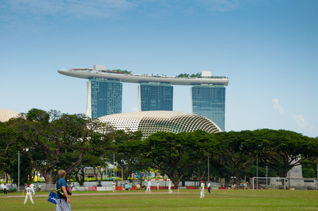 cricket field: SINGAPORE - JULY 2, 2016 : Singapore urban view with big trees, Cricket field and Marina bay sands hotel Editorial