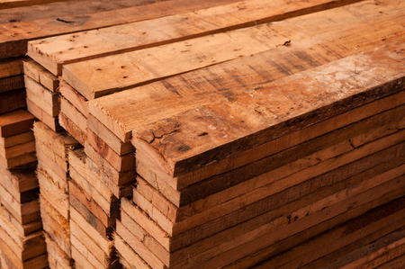 forest products: Edging wood board in stacks.