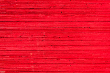 hardboard: cross section texture of particle board stacks in red color Stock Photo