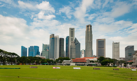 cricket field: Singapore-AUGUST  6,2016 : Singapore city skyline with buildings in business district view from Cricket field Editorial