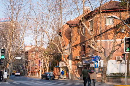 winter road: SHANGHAI, CHINA - JANUARY 28, 2017: old building on road side in winter in French concession in Shanghai.