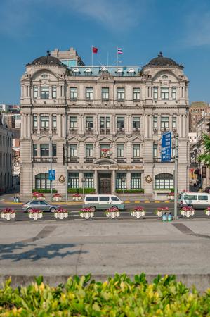 dozens: Shanghai, China - May 21, 2017 : historical building of Bangkok bank situated at the bund, Shanghai.The Shanghai Bund has dozens of historical buildings. Editorial