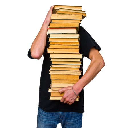 a student trying to keep a lot of their textbooks photo