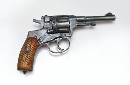 Old revolver on white background photo