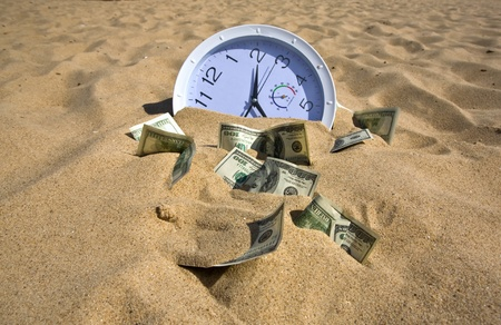 payday: sand absorbs time and money Stock Photo
