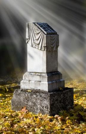 gravestones: sunlight falling on an old grave