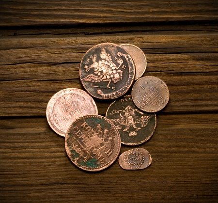 old coins of Russian Empire in the background of old weathered wood photo