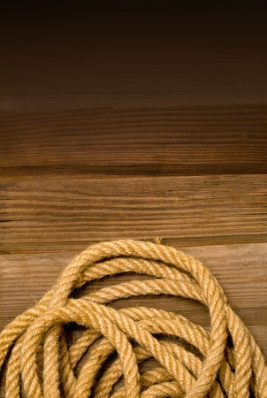 Naval rope on the wooden deck photo