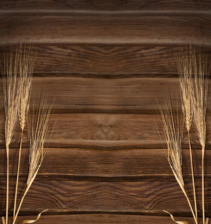 Wheat Ears on the Wood Background Stock Photo - 11600984