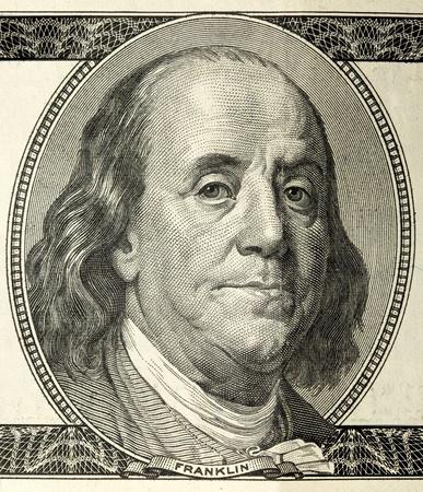 hundred dollar bill: close-up portrait of Franklin with hundred dollar bills