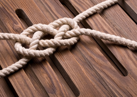 bonding rope: Marine knot on a wooden background