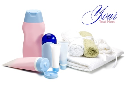 bottles of cosmetics for the care of the newborn on a white background photo