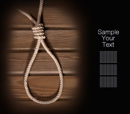 capital punishment: Rope loop hanging on gloomy wooden background Stock Photo