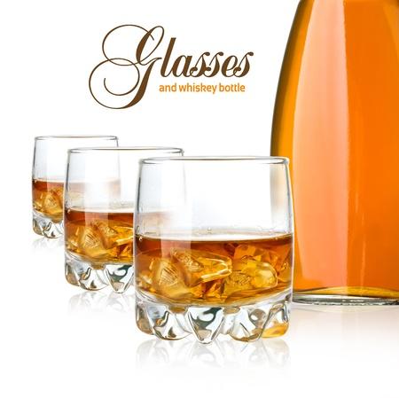 scotch whisky: Whisky bottle glasses and ice on white background