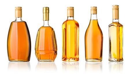 Set of whiskey bottles isolated on white background
