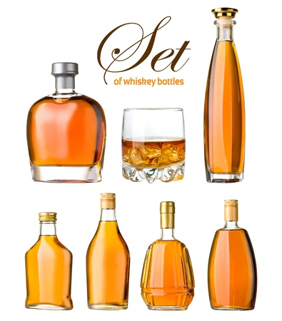 set of whiskey bottles and glass isolated photo
