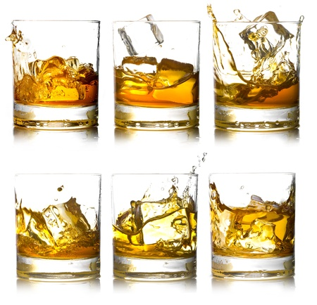 scotch whisky: Glass of scotch whiskey and ice on a white background Stock Photo