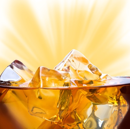 Whiskey with ice background