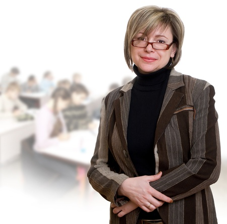 Happy teacher looking at camera with her students on background Stock Photo - 13157051