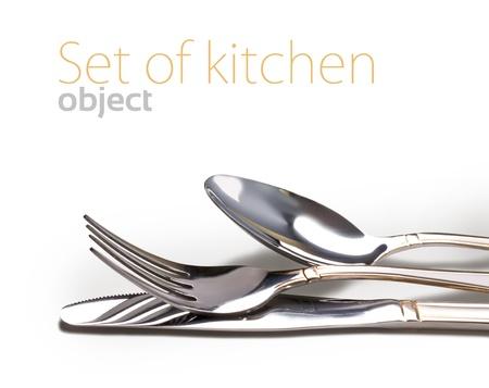 cubiertos de plata: Cuchillo, tenedor y cuchara aislados en blanco Foto de archivo