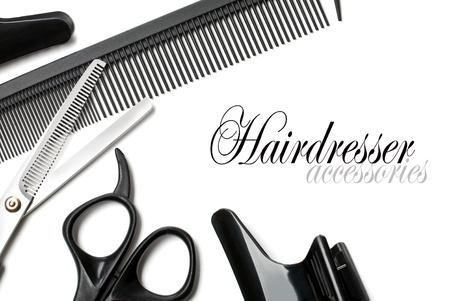 comb hair: forbici e pettine su uno sfondo bianco