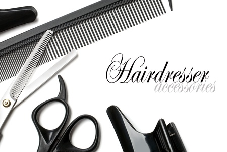 scissors and comb on a white background photo