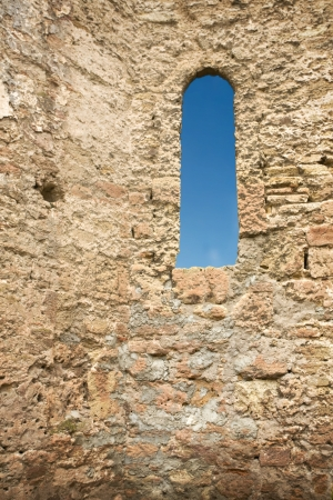 ancient prison: castle stone wall with a window Stock Photo