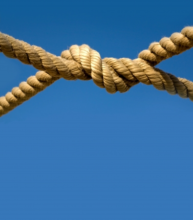 fray: Old fishing boat rope against blue sky Stock Photo