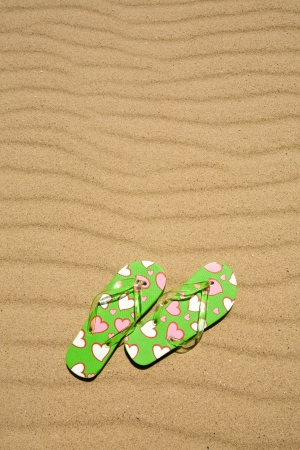 flip flops on beach sand photo