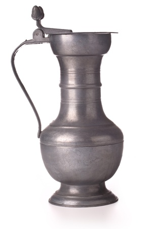 pewter: Antique pewter beer jug with lid on white background