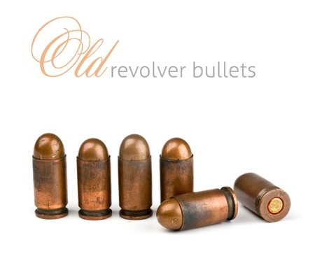 old revolver bullets on a white background photo