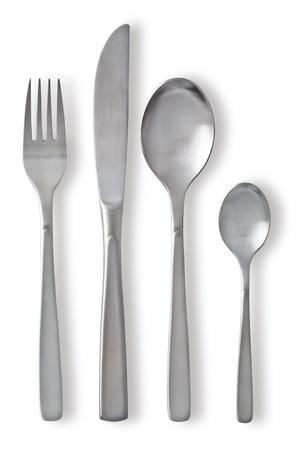 cubiertos de plata: Juego de cubiertos con Tenedor, cuchillo y cuchara en el fondo blanco