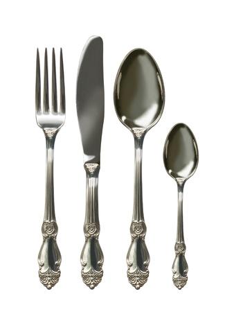 cubiertos de plata: Juego de cubiertos con Tenedor, cuchillo y cuchara aislados Foto de archivo