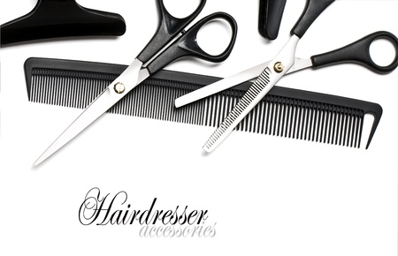 Scissors and Comb for hair isolated on white photo