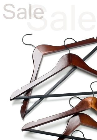 wooden clothes hangers as sale symbol isolated on white Stock Photo