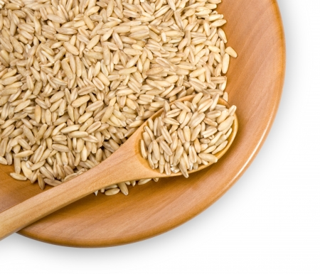 wooden plate with grains of  rye, close-up Stock Photo - 17570154